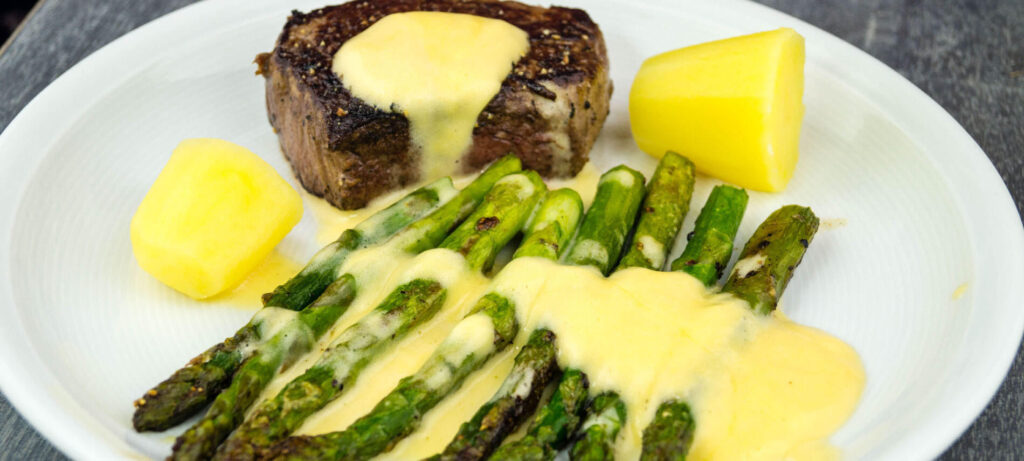 Decaent Bernaise Sauce over Meat and Asparagus
