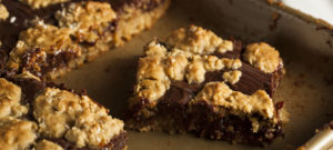Gooey chocolate bar cookies with an oatmeal cookie crust