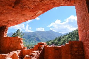 Garden of the Gods image of mountains and blue sky from within a cave