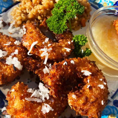Crispy Golden Fried Coconut Shrimp with a yellow pina colada dipping sauce