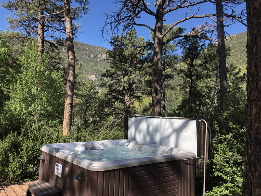 Private outdoor hot tub with mountain views