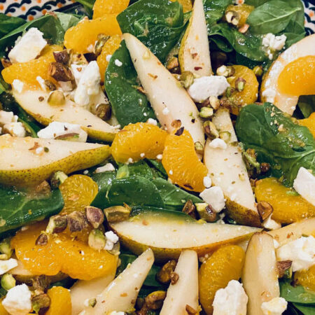 Irish Flag Salad with spinach, pear slices, mandarin oranges, feta cheese and pistachios