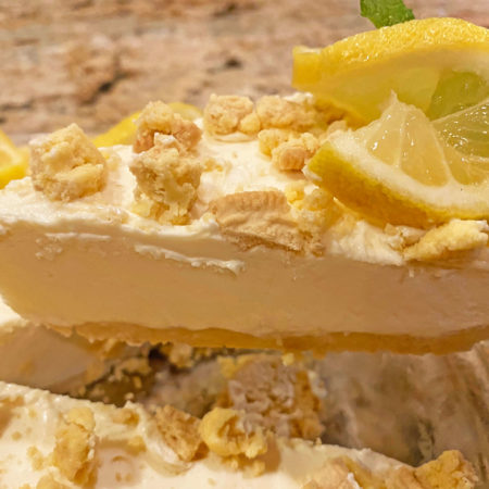 Creamy Lemon Pie with cookie crumb curst and toppings with a lemon twist