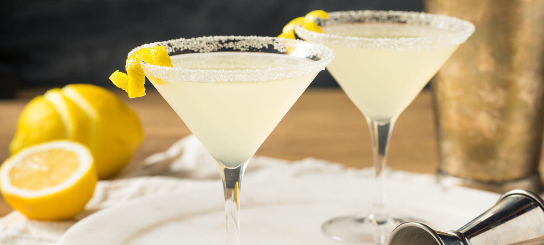 Yellow lemon Martini in clear glasses with lemons
