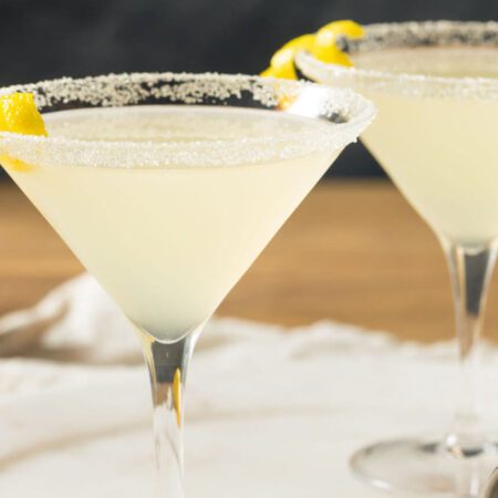 Yellow lemon Martini in clear glasses with lemons