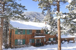 Rustic log lodge during the winter with snow