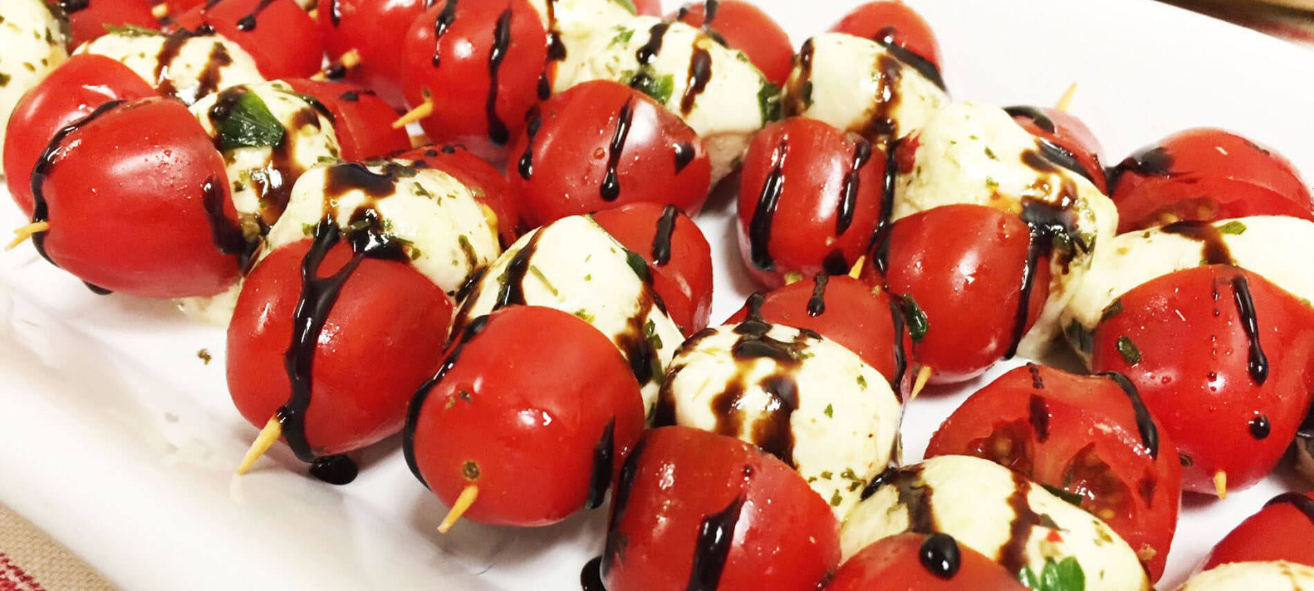 Mozzarella balls and cherry tomato kebabs with a balsamic glaze
