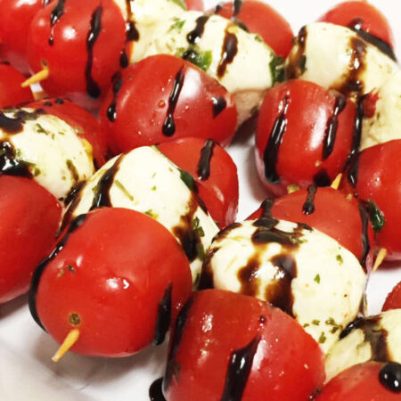 Mozzarella balls and cherry tomato kebabs with a balsamic glaze