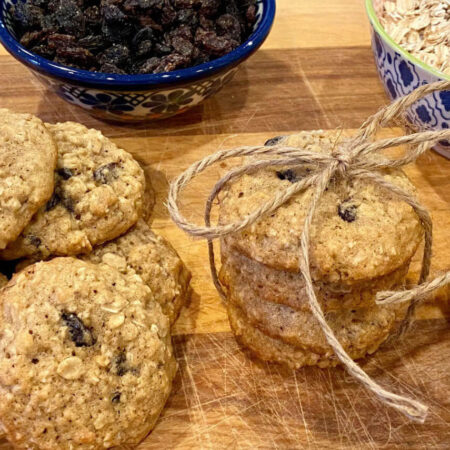 Oatmeal Raisin Cookies with bowls of oats and raisins