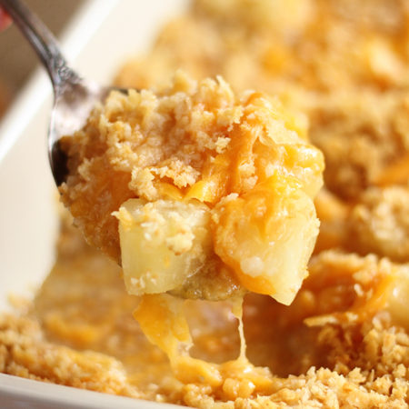 Pineapple Casserole with pineapple chunks, cheese, and a crumbly bread crumb topping