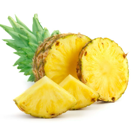 Fresh pineapple cut into slices and wedges