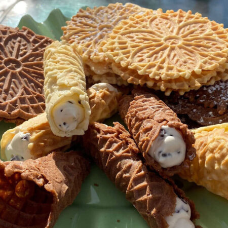 Chocolate and Golden crispy Pizzelle cookies, cream filled canoli and cones