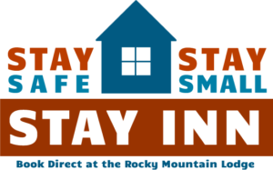 Blue House with red and blue wording saying Stay Safe, Stay Small, Stay Inn at Rocky Mountain Lodge