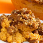 orange mashed sweet potatoes with a crispy pecan and brown sugar topping