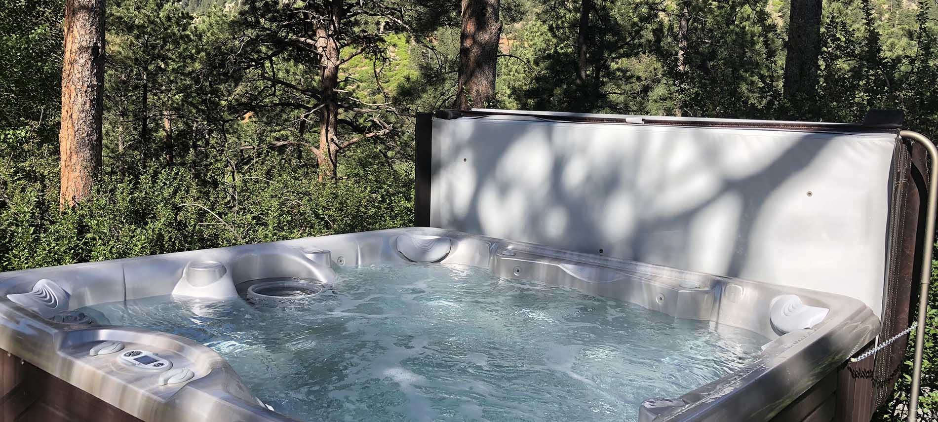 Hot tub in private space setting in the tree line overlooking the forrest