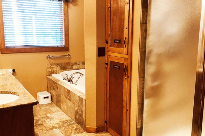 Bathroom entry with double vanity, large tub and standing shower